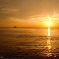 写真: 海も空も染めて