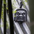 Photos: 寺町の裏道を睨む鬼瓦
