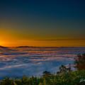 写真: 雲海と 御来光