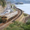 写真: 海岸線と或る列車
